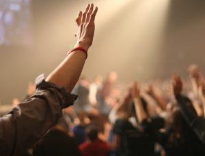 Hand raised in air in praise